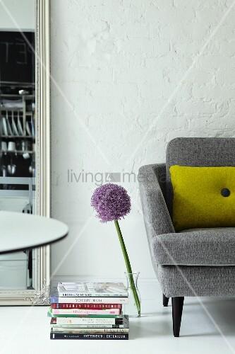 Retro sofa and allium in glass vase on floor