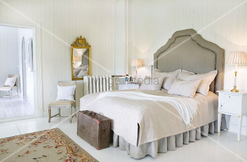 Shabby-chic bedroom in Norwegian manor house with white wood panelling