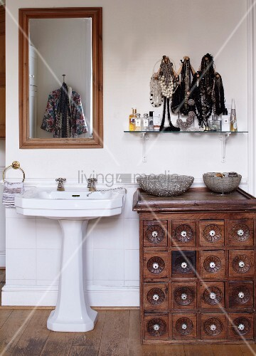 Antique apothecary cabinet next to pedestal sink in rustic bathroom : apothecary bathroom cabinet - Cheerinfomania.Com