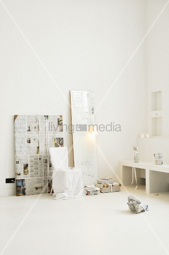 Dull mirror, loose-covered chair and gifts wrapped in newspaper