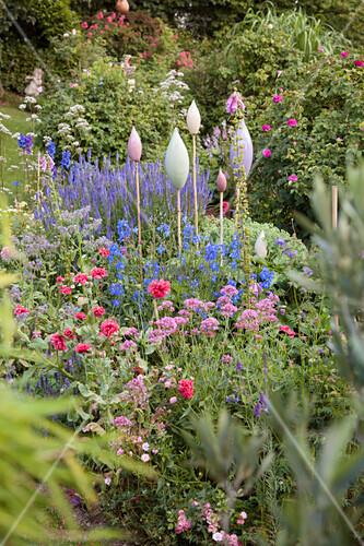 Ornamental rods in flowering garden