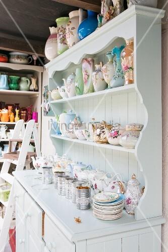 Vintage-style vases and jugs on white dresser