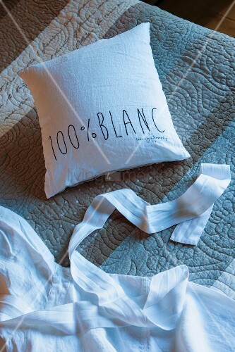 White cushion cover with lettering