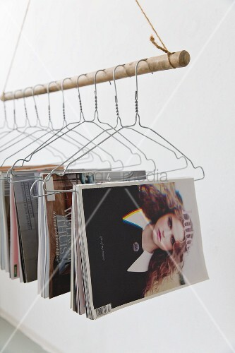 Magazine rack made from suspended and wire coat hangers