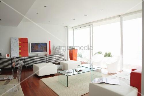 Designer interior with plexiglas furniture and orange accents