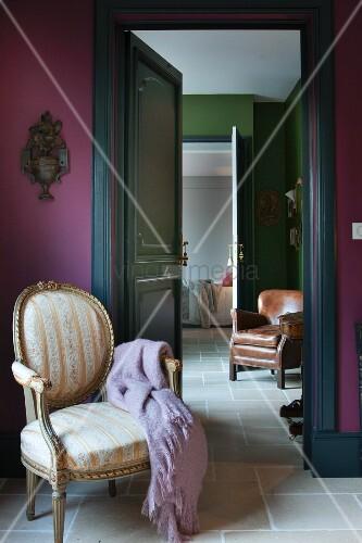 Blanket on Baroque armchair next to door