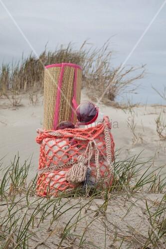 Straw beach mat in crocheted beach bag