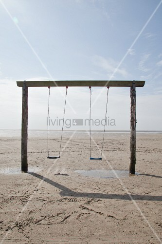 Simple set of swings on beach