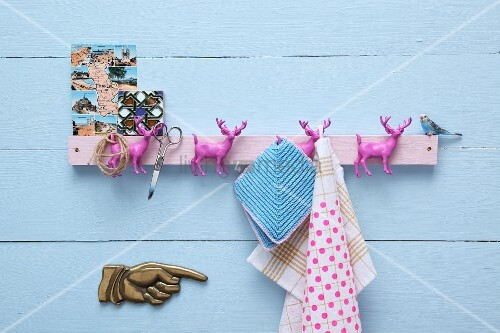 Hand-crafted hook rack with hooks made from pink stag figurines
