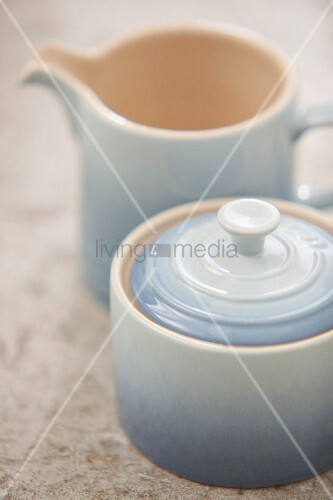 Pastel blue, ombré effect ceramic sugar bowl with lid and matching milk jug in