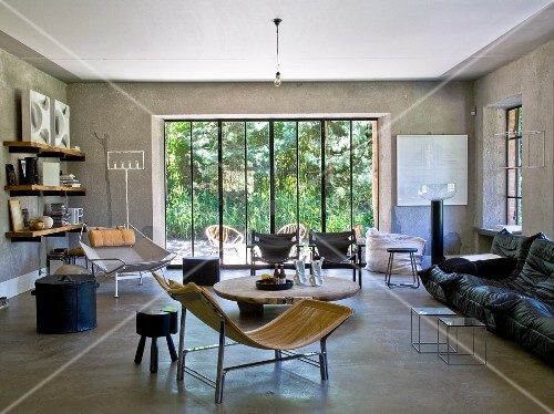 Interior with concrete walls and floors and furniture in 50s and 60s styles
