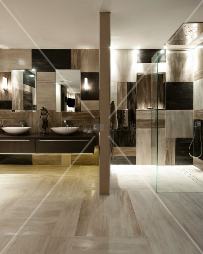 Masculine bathroom with floor-level shower and chequered wall tiles