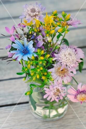Posy of garden flowers in glass