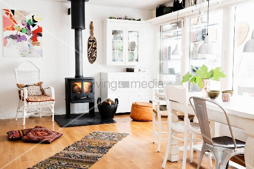 Log burner and glass wall in spacious dining room