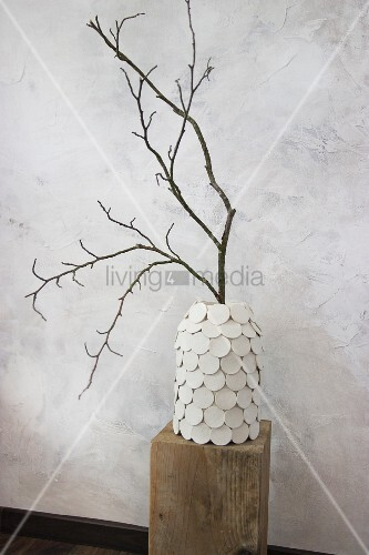 Branch in vase hand-made from preserving jar and modelling compound discs