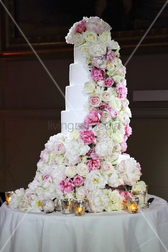 Multi-tiered wedding cake romantically decorated with roses