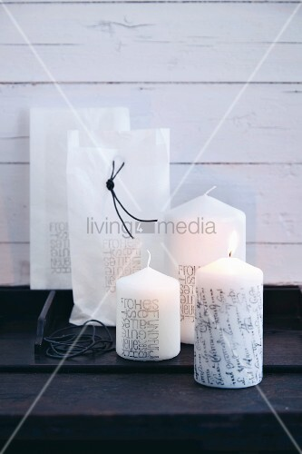 Pillar candles stamped with messages