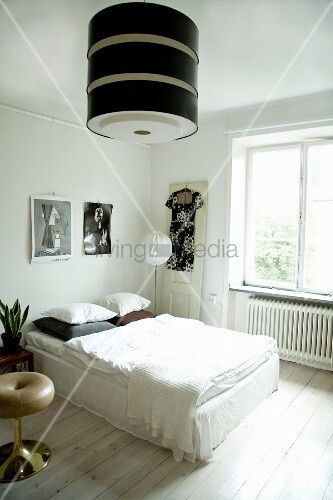 Large retro lampshade in bright bedroom