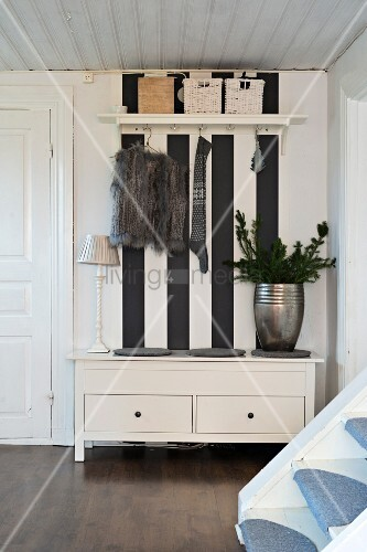 Trunk Bench Against Black And White Striped Wall In Cloakroom