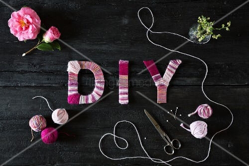 Symbolic DIY image with lettering wrapped in yarn