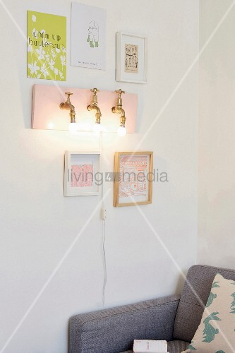 DIY wall-mounted lamp made from brass taps