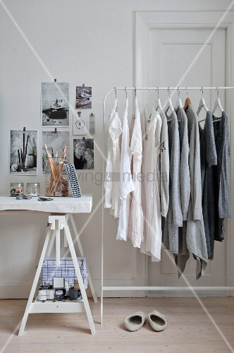 Clothing arranged by colour hung from clothes rack
