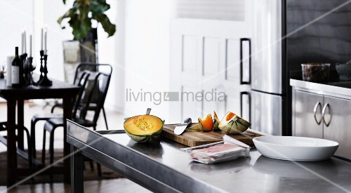 Ingredients and cooking utensils on counter in kitchen