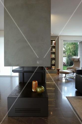 Vases in modern gas fireplace in elegant interior