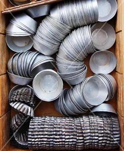 Stacks of various muffin tins