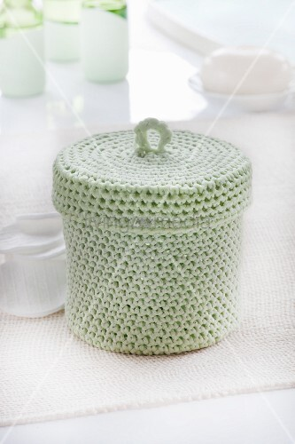 Pastel-green crocheted basket with lid