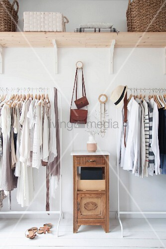 Clothes in natural shades on open clothes rails
