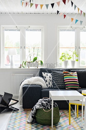 Splashes of colour and graphic patterns in living room
