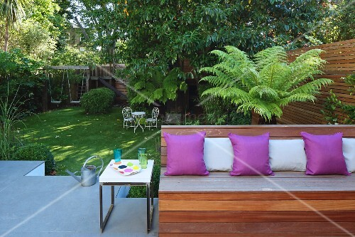 Cushions on wooden bench on terrace platform