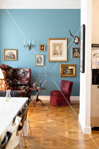 Easy chair and armchair against blue wall