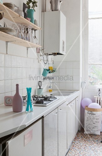 Accessories in pastel shades in kitchen of period apartment