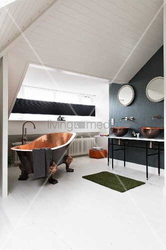 Copper bathtub and twin washstand in attic bathroom