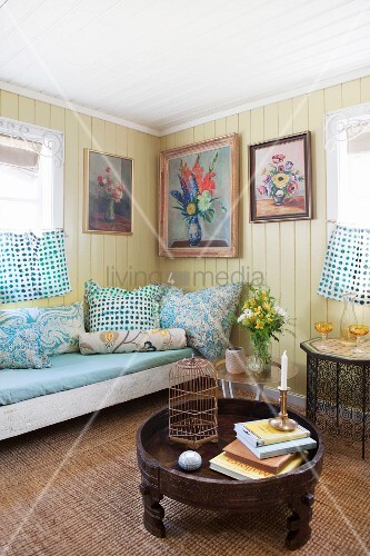Yellow board wall and couch in cosy living room