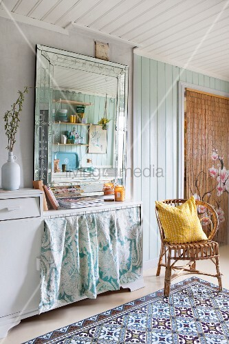 Vintage-style mirror and wicker chair in Bohemian kitchen