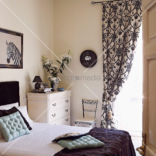 Opulent curtains in classic, black and white bedroom