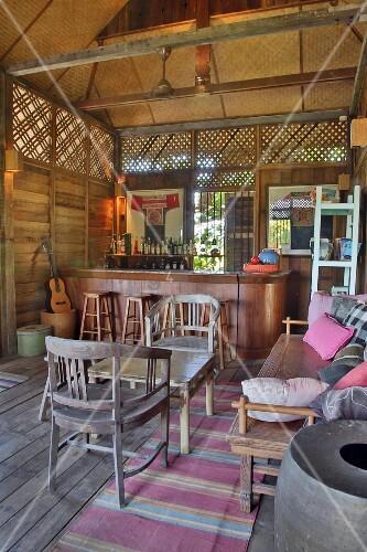 Bar in wood and bamboo cabin with lounge furniture, Langkawi, Malaysia