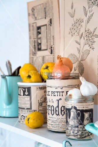 Glass jars covered in vintage-style printed paper and used for storage