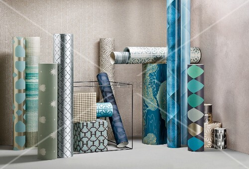 Rolls of wallpaper in various patterns and colours