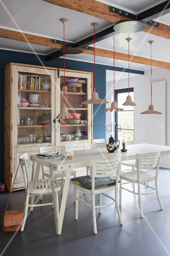 White table below various pendant lamps in dining room