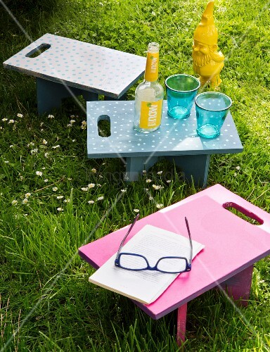 Colourful tray tables with handles for picnics
