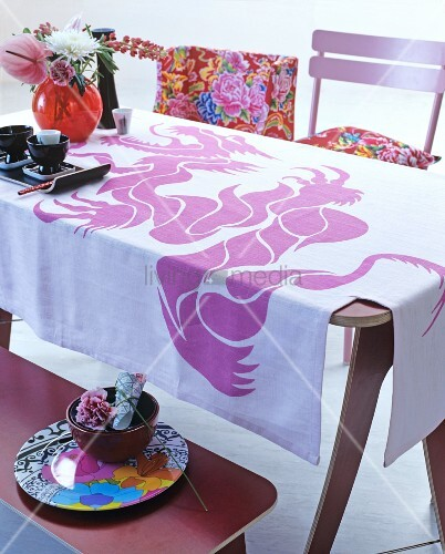 Tablecloth printed with pink dragon on Oriental-style dining table