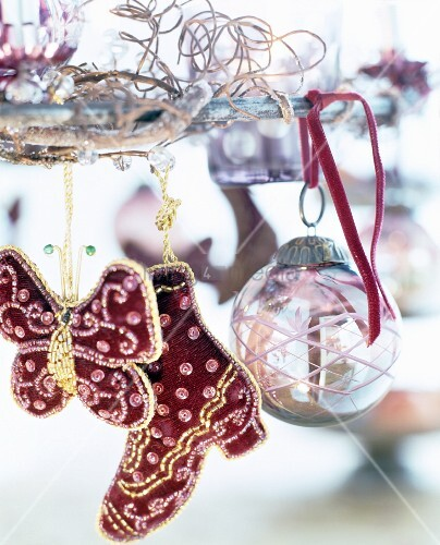 Artistically embroidered decorations and glass bauble hung from metal wreath