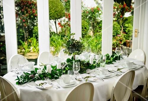 Elegant Christmas dinner table on veranda
