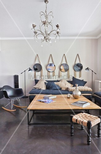 Living room in shades of grey with dark concrete floor