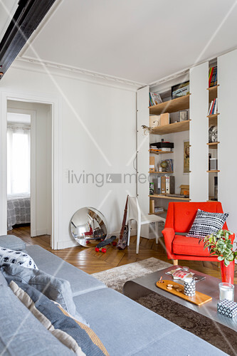 Shelving with integrated desk in living room of period apartment