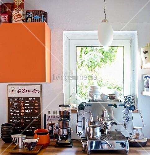 Italian coffee machine under kitchen window